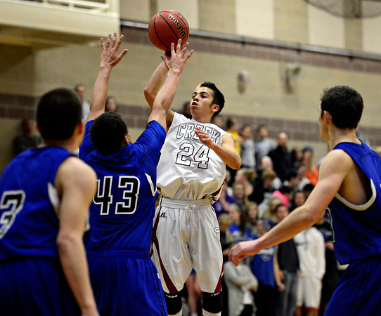 """Silver Creek's Chico Grine (24) looks to shoot over Longmont defenders during the game at Silver Creek High School on Tuesday, Jan. 29, 2013. Longmont beat Silver Creek 65-34. For more photos visit  <a href=""""http://www.BoCoPreps.com"""">http://www.BoCoPreps.com</a>.<br /> (Greg Lindstrom/Times-Call)"""