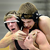 """Silver Creek's Sam Oliver, right, competes against Niwot's Damien O'Hare during the dual meet at Niwot High School on Wednesday, Jan. 23, 2013. For more photos visit  <a href=""""http://www.BoCoPreps.com"""">http://www.BoCoPreps.com</a>. <br /> (Greg Lindstrom/Times-Call)"""
