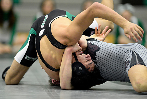 """Niwot's Matthew Strope struggles against Daniel McLean during the dual meet at Niwot High School on Wednesday, Jan. 23, 2013. For more photos visit  <a href=""""http://www.BoCoPreps.com"""">http://www.BoCoPreps.com</a>. <br /> (Greg Lindstrom/Times-Call)"""