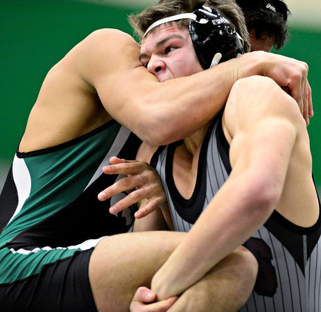 "Silver Creek's Daniel McLean competes against Niwot's Matthew Strope during the dual meet at Niwot High School on Wednesday, Jan. 23, 2013. For more photos visit  <a href=""http://www.BoCoPreps.com"">http://www.BoCoPreps.com</a>. <br /> (Greg Lindstrom/Times-Call)"
