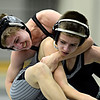 "Niwot's Austin Ivan, left, competes against Silver Creek's Patrick Murray during the dual meet at Niwot High School on Wednesday, Jan. 23, 2013. For more photos visit  <a href=""http://www.BoCoPreps.com"">http://www.BoCoPreps.com</a>. <br /> (Greg Lindstrom/Times-Call)"