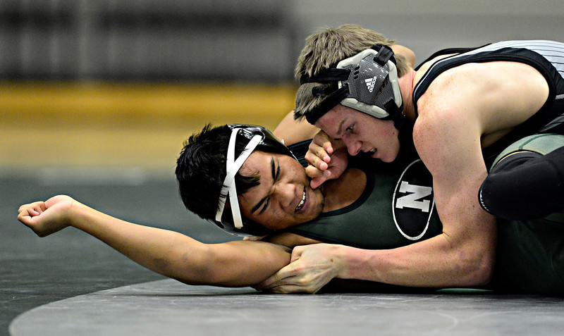 "Silver Creek's Justin McLean, right, competes against Niwot's Ranny Rorn during the dual meet at Niwot High School on Wednesday, Jan. 23, 2013. For more photos visit  <a href=""http://www.BoCoPreps.com"">http://www.BoCoPreps.com</a>. <br /> (Greg Lindstrom/Times-Call)"
