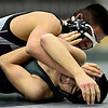 "Silver Creek's Jonathan Jimenez, top, competes against Niwot's Fernando Velasco-Ramirez during the dual meet at Niwot High School on Wednesday, Jan. 23, 2013. For more photos visit  <a href=""http://www.BoCoPreps.com"">http://www.BoCoPreps.com</a>. <br /> (Greg Lindstrom/Times-Call)"