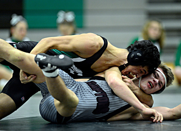 """Niwot's Matthew Strope, top, works against Daniel McLean during the dual meet at Niwot High School on Wednesday, Jan. 23, 2013. For more photos visit  <a href=""""http://www.BoCoPreps.com"""">http://www.BoCoPreps.com</a>. <br /> (Greg Lindstrom/Times-Call)"""