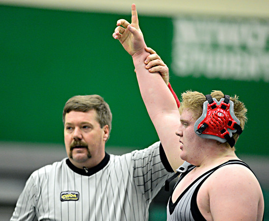 """Silver Creek's Andy Nott reacts after pinning Niwot's Mitchell Allen during the dual meet at Niwot High School on Wednesday, Jan. 23, 2013. For more photos visit  <a href=""""http://www.BoCoPreps.com"""">http://www.BoCoPreps.com</a>. <br /> (Greg Lindstrom/Times-Call)"""