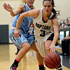 "Silver Creek's Nargaret Davis (3) drives past Valor Christian's Tess Warner (14) during the game at D'Evelyn High School on Friday, March 1, 2013. Silver Creek beat Valor Christian 65-48. For more photos visit  <a href=""http://www.BoCoPreps.com"">http://www.BoCoPreps.com</a>.<br /> (Greg Lindstrom/Times-Call)"