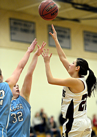 "Silver Creek's Carrie Ramirez (22) shoots over Valor Christian's Kendall Bradbury (32) during the game at D'Evelyn High School on Friday, March 1, 2013. Silver Creek beat Valor Christian 65-48. For more photos visit  <a href=""http://www.BoCoPreps.com"">http://www.BoCoPreps.com</a>.<br /> (Greg Lindstrom/Times-Call)"