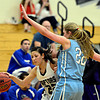 """Silver Creek's Carrie Ramirez (22) drives around Valor Christian's Caroline Bryan, right, during the game at D'Evelyn High School on Friday, March 1, 2013. Silver Creek beat Valor Christian 65-48. For more photos visit  <a href=""""http://www.BoCoPreps.com"""">http://www.BoCoPreps.com</a>.<br /> (Greg Lindstrom/Times-Call)"""