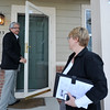 Legacy Real Estate Group Broker and Owner Garry Callis locks up a single family home while Broker Associate Lisa Henry looks on after taking a look at it, Tuesday, Jan. 8, 2013, in Longmont.<br /> (Matthew Jonas/Times-Call)