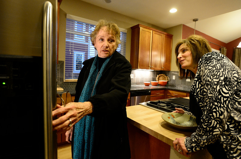 Home buyer Barbara McCormick checks out the appliances with Wright Kingdom Real Estate agent Dene Yarwood, Wednesday, Jan. 9, 2013, in Longmont.<br /> (Matthew Jonas/Times-Call)