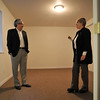 From left: Legacy Real Estate Group Broker and Owner Garry Callis talks with Broker Associate Lisa Henry as they look at a finished room in a basement of a single family home, Tuesday, Jan. 8, 2013, in Longmont.<br /> (Matthew Jonas/Times-Call)