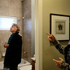 Home buyer Barbara McCormick check out the tile inside a bathroom of a home with Wright Kingdom Real Estate agent Dene Yarwood, Wednesday, Jan. 9, 2013, in Longmont.<br /> (Matthew Jonas/Times-Call)