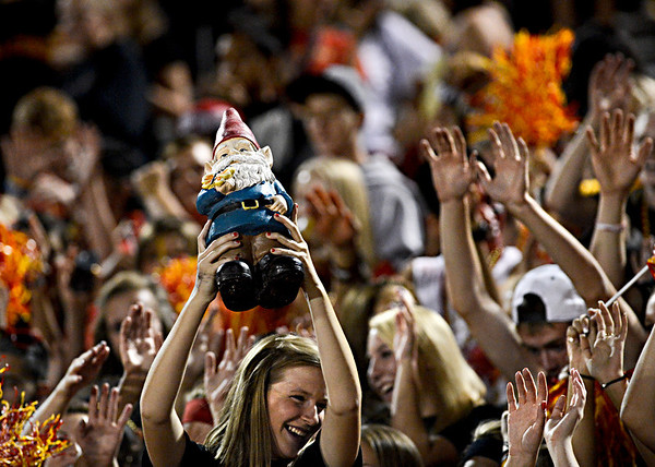 "Skyline senior Hannah Truesdale holds a gnome as the Falcon student section cheers during the second half.  Seniors Pratik Karki and Aiman Latrache brought the gnome for good luck.  Thompson Valley beat Skyline 34-14 during the varsity football game at Everly-Montgomery Field on Thursday, Sept. 6, 2012.  For more photos visit  <a href=""http://www.TimesCall.com"">http://www.TimesCall.com</a>.<br /> (Greg Lindstrom/Times-Call)"