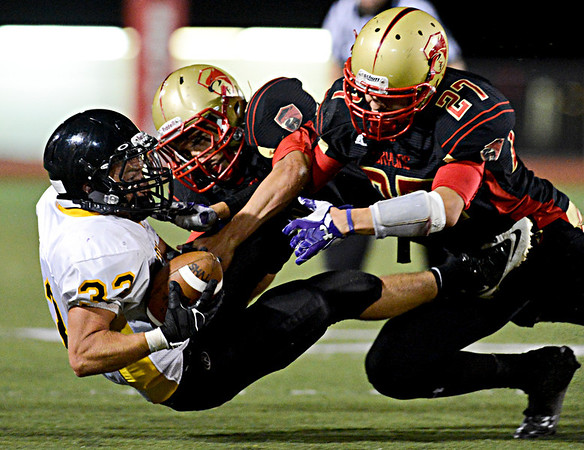 """Skyline's Luciano Quesada (27) and Alex McHone tackle Thompson Valley's Ryan Pinn (33) during the second half.  Thompson Valley beat Skyline 34-14 during the varsity football game at Everly-Montgomery Field on Thursday, Sept. 6, 2012.  For more photos visit  <a href=""""http://www.TimesCall.com"""">http://www.TimesCall.com</a>.<br /> (Greg Lindstrom/Times-Call)"""