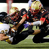 "Skyline's Luciano Quesada (27) and Alex McHone tackle Thompson Valley's Ryan Pinn (33) during the second half.  Thompson Valley beat Skyline 34-14 during the varsity football game at Everly-Montgomery Field on Thursday, Sept. 6, 2012.  For more photos visit  <a href=""http://www.TimesCall.com"">http://www.TimesCall.com</a>.<br /> (Greg Lindstrom/Times-Call)"