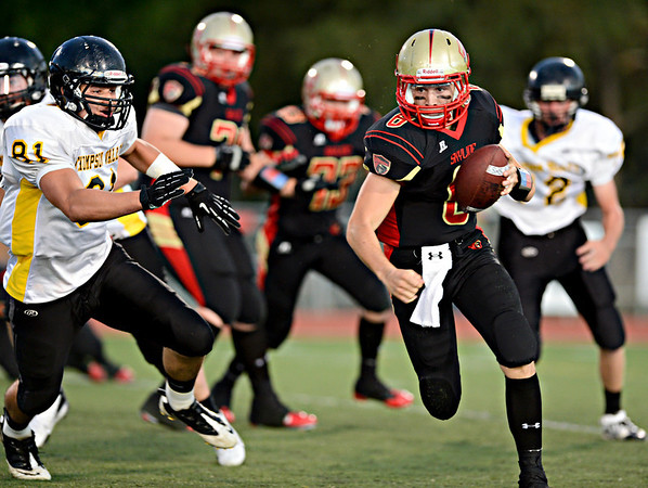 """Skyline quarterback Garret Angstead looks for a hole during the first half.  Skyline faces Thompson Valley during the varsity football game at Everly-Montgomery Field on Thursday, Sept. 6, 2012.  For more photos visit  <a href=""""http://www.TimesCall.com"""">http://www.TimesCall.com</a>.<br /> (Greg Lindstrom/Times-Call)"""