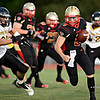 "Skyline quarterback Garret Angstead looks for a hole during the first half.  Skyline faces Thompson Valley during the varsity football game at Everly-Montgomery Field on Thursday, Sept. 6, 2012.  For more photos visit  <a href=""http://www.TimesCall.com"">http://www.TimesCall.com</a>.<br /> (Greg Lindstrom/Times-Call)"