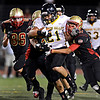 """Thompson Valley's Francisco Marquez (21) tries to break through the Skyline defense on a run during the first half.  Skyline faces Thompson Valley during the varsity football game at Everly-Montgomery Field on Thursday, Sept. 6, 2012.  For more photos visit  <a href=""""http://www.TimesCall.com"""">http://www.TimesCall.com</a>.<br /> (Greg Lindstrom/Times-Call)"""