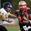 """Skyline's Israel Valdez (20) runs past Thompson Valley's Cody Draeger (26) during the first half.  Skyline faces Thompson Valley during the varsity football game at Everly-Montgomery Field on Thursday, Sept. 6, 2012.  For more photos visit  <a href=""""http://www.TimesCall.com"""">http://www.TimesCall.com</a>.<br /> (Greg Lindstrom/Times-Call)"""