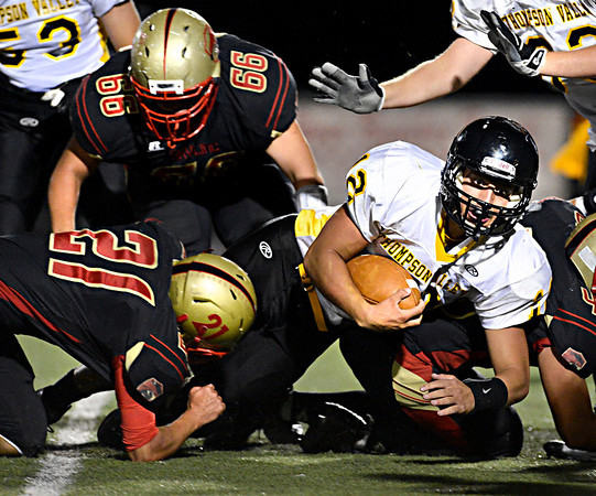 """Thompson Valley's Spencer Shook (12) scores on a two point conversion during the second half.  Thompson Valley beat Skyline 34-14 during the varsity football game at Everly-Montgomery Field on Thursday, Sept. 6, 2012.  For more photos visit  <a href=""""http://www.TimesCall.com"""">http://www.TimesCall.com</a>.<br /> (Greg Lindstrom/Times-Call)"""