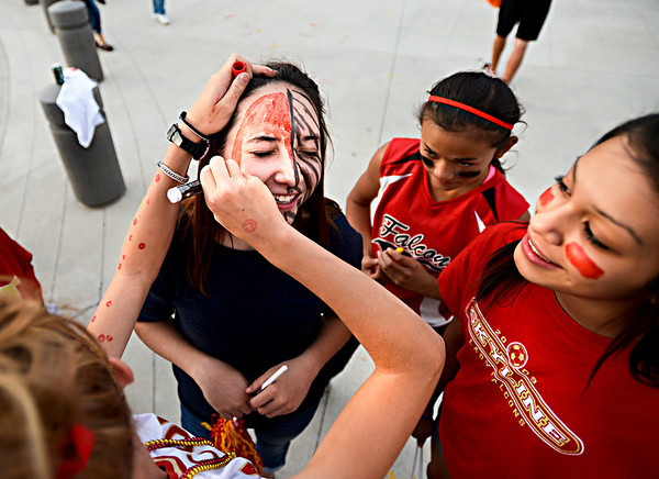 "Sydney Richards paints the face of fellow sophomore Abby Sabo before the game.  Thompson Valley beat Skyline 34-14 during the varsity football game at Everly-Montgomery Field on Thursday, Sept. 6, 2012.  For more photos visit  <a href=""http://www.TimesCall.com"">http://www.TimesCall.com</a>.<br /> (Greg Lindstrom/Times-Call)"