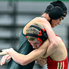 "Skyline's Braden Richards, right, tries to lift Niwot's Fernando Velasco-Ramirez during the match at Niwot High School on Wednesday, Jan. 9, 2013. For more photos visit  <a href=""http://www.BoCoPreps.com"">http://www.BoCoPreps.com</a>.<br /> (Greg Lindstrom/Times-Call)"