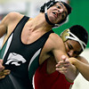 """Niwot's Matthew Strope, left, is shoved by Skyline's Jesus Contreras during the match at Niwot High School on Wednesday, Jan. 9, 2013. For more photos visit  <a href=""""http://www.BoCoPreps.com"""">http://www.BoCoPreps.com</a>.<br /> (Greg Lindstrom/Times-Call)"""