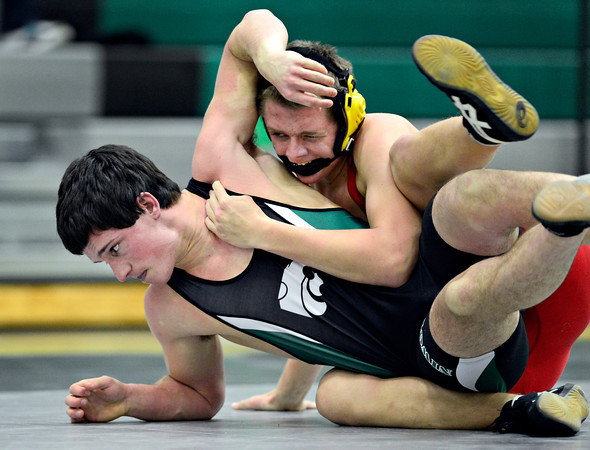 "Niwot's Sean Harrison, left, competes against Skyline's Steven Feltenberger during the match at Niwot High School on Wednesday, Jan. 9, 2013. For more photos visit  <a href=""http://www.BoCoPreps.com"">http://www.BoCoPreps.com</a>.<br /> (Greg Lindstrom/Times-Call)"