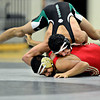 """Niwot's Matthew Strope gets position on Skyline's Jesus Contreras during the match at Niwot High School on Wednesday, Jan. 9, 2013. For more photos visit  <a href=""""http://www.BoCoPreps.com"""">http://www.BoCoPreps.com</a>.<br /> (Greg Lindstrom/Times-Call)"""