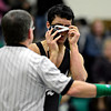 """Niwot's Matthew Strope tries to adjust his headgear during the match at Niwot High School on Wednesday, Jan. 9, 2013. For more photos visit  <a href=""""http://www.BoCoPreps.com"""">http://www.BoCoPreps.com</a>.<br /> (Greg Lindstrom/Times-Call)"""
