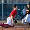 """Skyline catcher Garret Angstead tries to block a throw as Adams City's Eric Gomez slides safely into home during the game at Skyline High School on Thursday, March 7, 2013. Skyline beat Adams City 30-2. For more photos visit  <a href=""""http://www.BoCoPreps.com"""">http://www.BoCoPreps.com</a>.<br /> (Greg Lindstrom/Times-Call)"""
