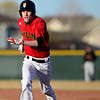 "Skyline's Justin Forsyth runs back to first base to tag up on a play during the game at Skyline High School on Thursday, March 7, 2013. Skyline beat Adams City 30-2. For more photos visit  <a href=""http://www.BoCoPreps.com"">http://www.BoCoPreps.com</a>.<br /> (Greg Lindstrom/Times-Call)"