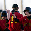 """Skyline's Blake Pair, right, celebrates with teammates during the game at Skyline High School on Thursday, March 7, 2013. Skyline beat Adams City 30-2. For more photos visit  <a href=""""http://www.BoCoPreps.com"""">http://www.BoCoPreps.com</a>.<br /> (Greg Lindstrom/Times-Call)"""