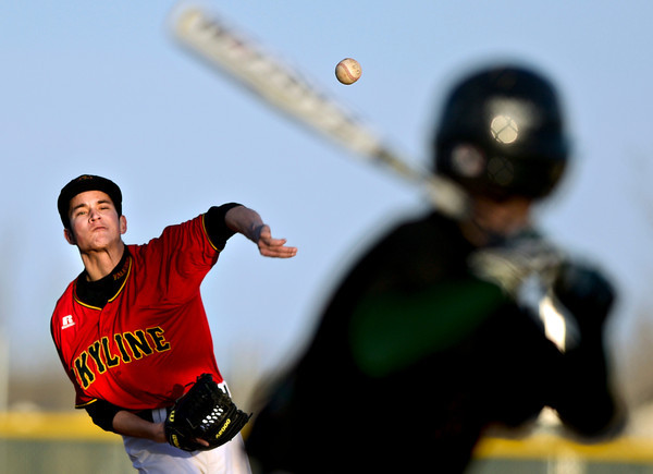 """Skyline's Aaron Soriano delivers a pitch during the game at Skyline High School on Thursday, March 7, 2013. Skyline beat Adams City 30-2. For more photos visit  <a href=""""http://www.BoCoPreps.com"""">http://www.BoCoPreps.com</a>.<br /> (Greg Lindstrom/Times-Call)"""