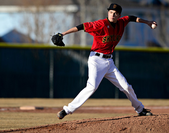 "Skyline's Aaron Soriano delivers a pitch during the game at Skyline High School on Thursday, March 7, 2013. Skyline beat Adams City 30-2. For more photos visit  <a href=""http://www.BoCoPreps.com"">http://www.BoCoPreps.com</a>.<br /> (Greg Lindstrom/Times-Call)"