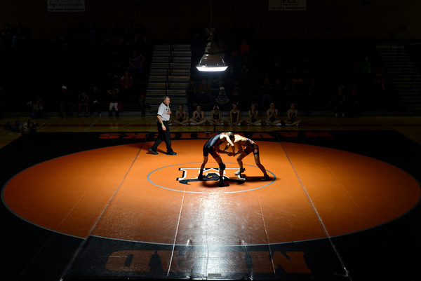 "Skyline's Braden Richards, left, competes against Mead's Dyllan Burch during the dual meet at Mead High School on Wednesday, Jan. 24, 2013. For more photos visit  <a href=""http://www.BoCoPreps.com"">http://www.BoCoPreps.com</a>.<br /> (Greg Lindstrom/Times-Call)"