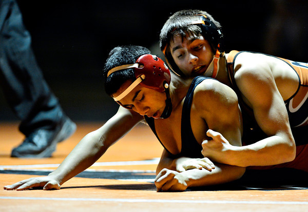 """Mead's Sage Budd, right, competes against Skyline's Ruben Rivera during the dual meet at Mead High School on Wednesday, Jan. 24, 2013. For more photos visit  <a href=""""http://www.BoCoPreps.com"""">http://www.BoCoPreps.com</a>.<br /> (Greg Lindstrom/Times-Call)"""