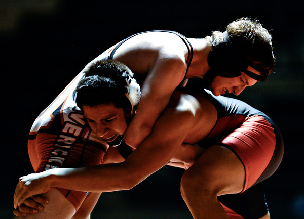 """Mead's Michael Burnett, top, competes against Skyline's Jesus Contreras during the dual meet at Mead High School on Wednesday, Jan. 24, 2013. For more photos visit  <a href=""""http://www.BoCoPreps.com"""">http://www.BoCoPreps.com</a>.<br /> (Greg Lindstrom/Times-Call)"""