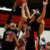 """Skyline's Dominic Mansanares, center, competes for a rebound against Sterling's Lucan Lingreen (25) and Jacob Suter (22) during the game at Skyline High School on Friday, Dec. 7, 2012. Skyline lost 44-35. For more photos visit  <a href=""""http://www.BoCoPreps.com"""">http://www.BoCoPreps.com</a>.<br /> (Greg Lindstrom/Times-Call)"""
