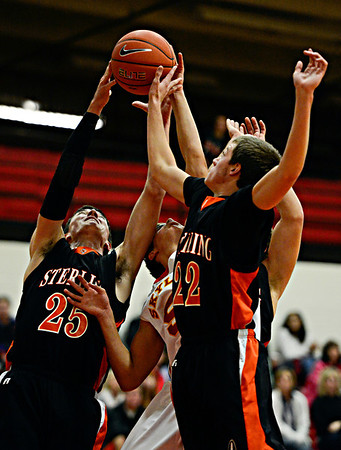 "Skyline's Dominic Mansanares, center, competes for a rebound against Sterling's Lucan Lingreen (25) and Jacob Suter (22) during the game at Skyline High School on Friday, Dec. 7, 2012. Skyline lost 44-35. For more photos visit  <a href=""http://www.BoCoPreps.com"">http://www.BoCoPreps.com</a>.<br /> (Greg Lindstrom/Times-Call)"