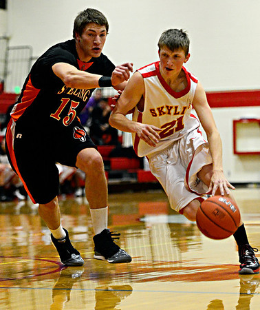 "Skyline's Dustin Mandrell (21) tries to drive past Sterling's Connor Carey (15) during the game at Skyline High School on Friday, Dec. 7, 2012. Skyline lost 44-35. For more photos visit  <a href=""http://www.BoCoPreps.com"">http://www.BoCoPreps.com</a>.<br /> (Greg Lindstrom/Times-Call)"