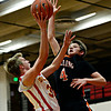 """Skyline's Travis Stuvel tries to shoot over Sterling's Ethan Rose (4) during the game at Skyline High School on Friday, Dec. 7, 2012. For more photos visit  <a href=""""http://www.BoCoPreps.com"""">http://www.BoCoPreps.com</a>.<br /> (Greg Lindstrom/Times-Call)"""