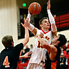 """Skyline's Colton Dabney shoots over Sterling's Ethan Rose (4) and Matt McNear during the game at Skyline High School on Friday, Dec. 7, 2012. For more photos visit  <a href=""""http://www.BoCoPreps.com"""">http://www.BoCoPreps.com</a>.<br /> (Greg Lindstrom/Times-Call)"""