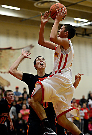 """Skyline's Aaron Soriano goes up for a shot against Sterling's Collin Sanger during the game at Skyline High School on Friday, Dec. 7, 2012. Skyline lost 44-35. For more photos visit  <a href=""""http://www.BoCoPreps.com"""">http://www.BoCoPreps.com</a>.<br /> (Greg Lindstrom/Times-Call)"""