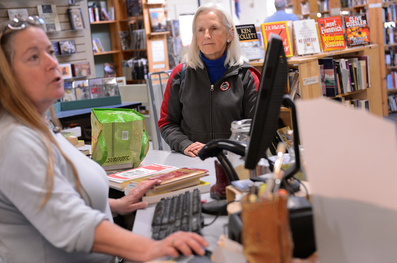 Owner Kathe Heinecken, left, buys books from Margaret Halsey, of Longmont, center, at Barbed Wire Books on Main Street, Friday, Nov. 23, 2012, in Longmont.<br /> (Matthew Jonas/Times-Call)
