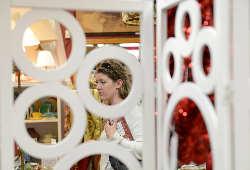 Michelle Arentzen, of Longmont, is seen through a room divider as she browses through home decorations at Fabulous Finds Upscale Consignment, Friday, Nov. 23, 2012, in Longmont.<br /> (Matthew Jonas/Times-Call)