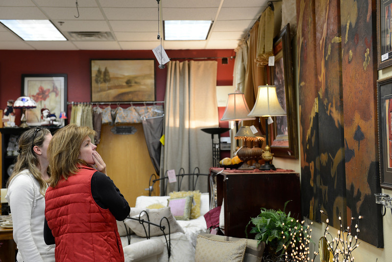 From left: Michelle Arentzen and her mother Susan Rickert, both of Longmont, check out a painting at Fabulous Finds Upscale Consignment, Friday, Nov. 23, 2012, in Longmont.<br /> (Matthew Jonas/Times-Call)