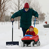 Nina Bennett pushes snow and her one-year-old granddaughter Sarah (no last name given) in Erie Thursday morning Feb. 21, 2013 in Erie. (Lewis Geyer/Times-Call)