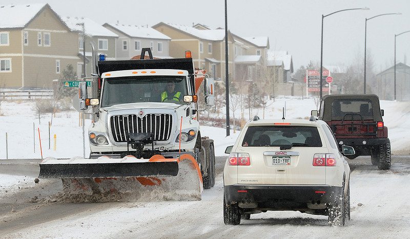A snow plow makes its way down Austin Avenue in Erie Thursday morning Feb. 21, 2013 in Erie. (Lewis Geyer/Times-Call)