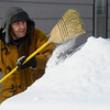 William Martinez clears snow from his car in front of his home on Terry Street, near 11th Avenue, Thursday morning Feb. 21, 2013. Martinez said he was going out for a cup of coffee. (Lewis Geyer/Times-Call)